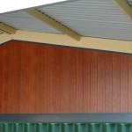 Wood grain slat fencing by Craftsman Fencing